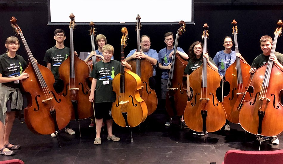 Phillip Serna directing OPUS Chamber Music Camp's double bass students.